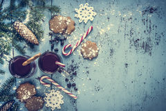 Christmas background with mulled wine, gingerbread, candy cane and fir tree decoration. Stock Image