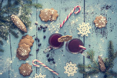 Christmas background with mulled wine, gingerbread, candy cane and fir tree decoration. Stock Images