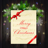 Christmas background. With music paper ribbon and lights on a wood wall Stock Photo