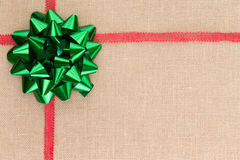 Christmas background on natural burlap textile Stock Images