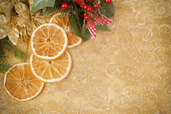 Christmas background with needles and orange slices Stock Photos