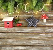 Christmas background. New year background with fir branches, xmas toys and a luminous garland Stock Photography