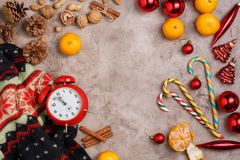 Christmas background. New Year`s holiday with tangerines and sweets. View from above. Free space for your text. Flat lay stock image