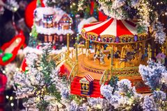 Christmas background with the new year toys carousel horses, pr. Christmas background with the new year toys, carousel horses, presents and decorations Royalty Free Stock Photos