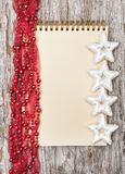 Christmas background with notebook and garland Royalty Free Stock Image
