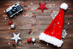 Christmas background with old camera, Santa's hat and decorations. Stock Images