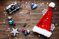 Christmas background with old camera, Santa's hat and decorations. Stock Photography