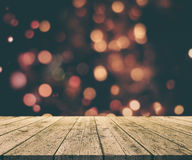Christmas background with old wooden table against bokeh lights. 3D render of a Christmas background with old wooden table against bokeh lights background Stock Photos