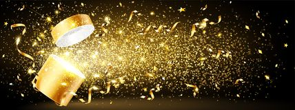 Golden gift with confetti Stock Photos