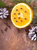 Christmas background with orange, cloves, stars and fir branches on wooden background Stock Photos