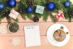 Christmas background with ornament  and decorated evergreen bran. Ches of fir  on the wooden pink table. Copy space for holiday text.  Xmas trendy card Stock Images