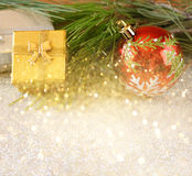 Christmas background with ornament, gift box and fir over table. Royalty Free Stock Photo