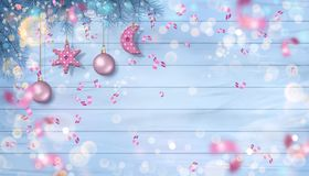 Christmas Background with Ornaments. Christmas vector ornaments, flying defocused confetti and branches of fir tree with hanging textile decorations on a wooden Stock Photos