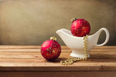 Christmas background with ornaments and gravy boat Royalty Free Stock Photo