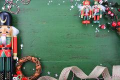 Christmas background with ornaments on green wood table. Happy Holidays Christmas background with copy space and borders decorated with ornaments on a rustic Royalty Free Stock Photos