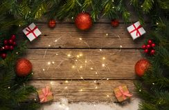 Christmas lights background decoration and gift on wooden floor. Christmas background, ornaments on old wooden floor royalty free stock images