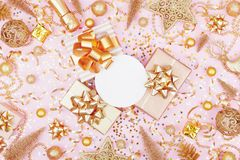 Christmas background with paper blank, gift or present box and golden holiday decoration top view. Flat lay stock photo