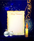 Christmas background with paper and candle Royalty Free Stock Image