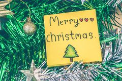 Christmas background and paper note merry christmas decor on background.  royalty free stock images