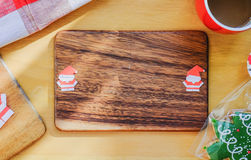 Christmas background of paper Santa on wooden plate. Paper Santa on wooden plate. Christmas theme Royalty Free Stock Photography