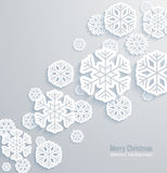 Christmas background with paper snowflakes. Royalty Free Stock Photo