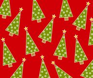 Christmas Background Pattern. A background pattern featuring randomly placed Christmas trees on red Royalty Free Stock Photo