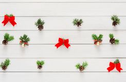 Christmas background with small balls and green branches on wood Royalty Free Stock Image