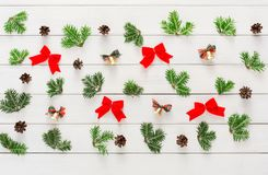 Christmas background with small balls and green branches on wood Royalty Free Stock Images