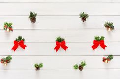 Christmas background with small balls and green branches on wood Royalty Free Stock Photography