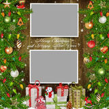 Christmas background with photo frames, pine strong, gifts and Christmas decorations Royalty Free Stock Photos