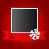 Christmas background. Photo on a red background decorated with white snowflakes Royalty Free Stock Images