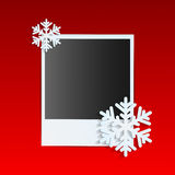 Christmas background. Photo on a red background decorated with white snowflakes Royalty Free Stock Image