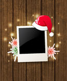 Christmas background with photo and Santa's hat Stock Image