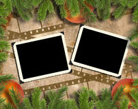 The Christmas background with photoframeworks. In. The Christmas background image with interesting texture old paper, photo-frameworks, a  filmstrip and tree Royalty Free Stock Photo