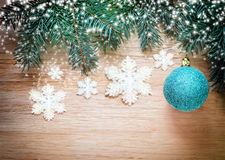 Christmas background. Pine and blue ball. Stock Images