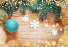 Christmas background. Pine and blue ball. Royalty Free Stock Photo