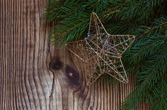 Christmas background with a pine branch on rustic board Royalty Free Stock Photos
