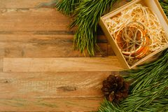 Christmas background. Pine branches and a box for a gift royalty free stock photos