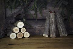 Christmas Background With Pine Branches and Wood logs On a Rusti Stock Images