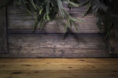 Christmas Background With Pine Branches and Wood logs On a Rusti Royalty Free Stock Images