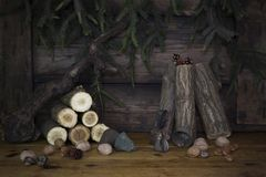 Christmas Background With Pine Branches and Wood logs On a Rusti Stock Photography