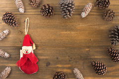 Christmas background. Pine cone on wood Royalty Free Stock Image
