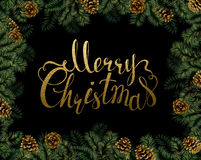 Christmas background with pine cones and branches frame. Festive decorative holiday gold texture lettering. Dark Christmas background with pine cones and Stock Photos