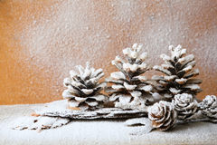 Christmas background with pine cones, decorations Stock Image
