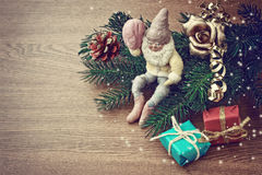 Christmas background with pine cones, gift and old gnome Stock Photos