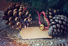 Christmas background with pine cones, gold bell Royalty Free Stock Photos