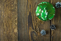 Christmas background with pine cones and green ball Royalty Free Stock Photos