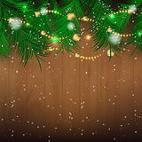 Christmas background with pine needles, bauble and glitter for greeting card Stock Image