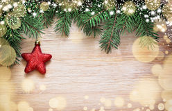 Christmas background. Pine, star and snow. Royalty Free Stock Image