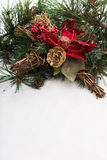 Christmas background with pine tree branch, pine cones, red flower and snow Stock Image